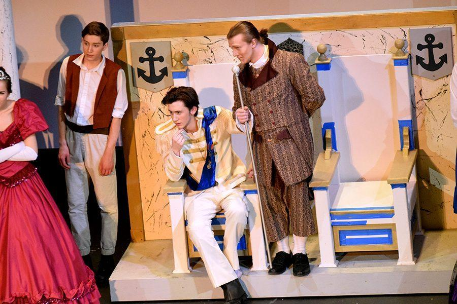 Prince Eric (Nick Hagen) and Grimsby (Isaiah DaMitz) listen to princesses to see if one of them is the voice that haunts him.