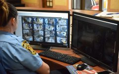 Officer Appel scanning over the OHS security cameras