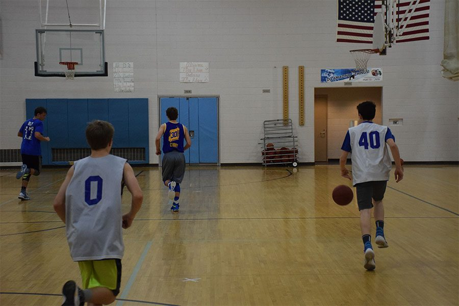 Marcus Andrist brings ball up the floor