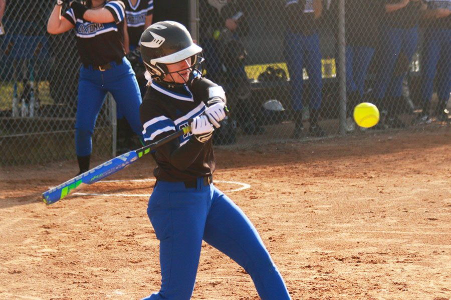 Senior Ellie Rohman takes a swing