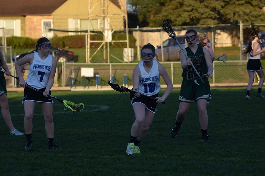 Sophomore Taylor Woltman preparing to grab a ground ball