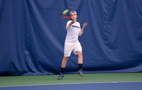 Sophomore Cody Bussert hits a forehand