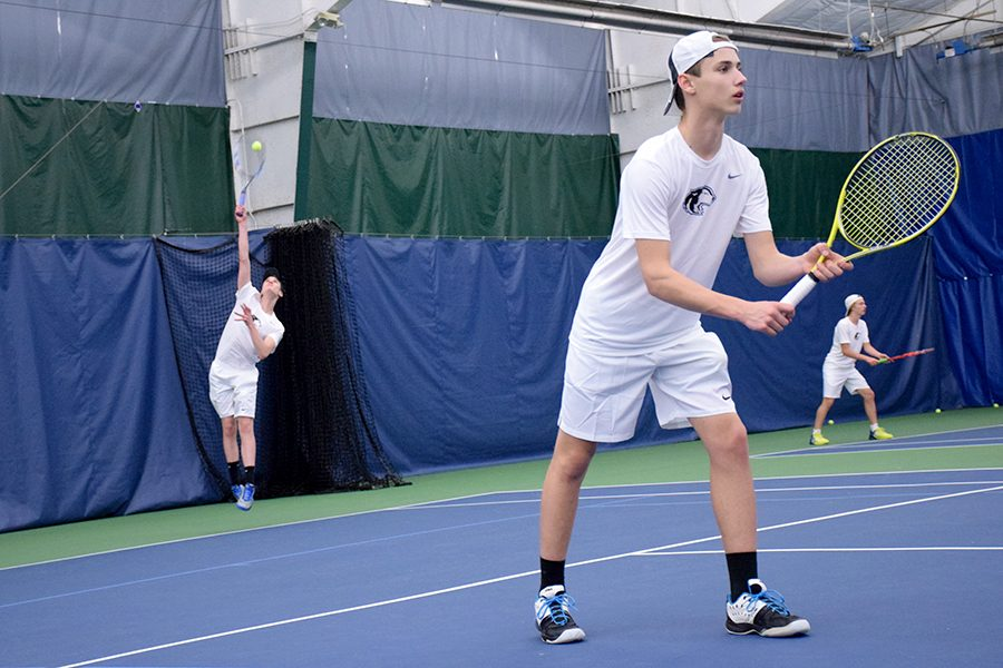 Sophomore Spencer Intress serves as teammate 8th grader Lincoln Maher stands ready
