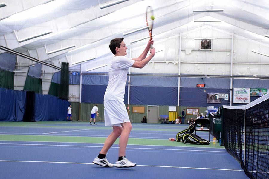 Junior Ben DeNio hits a volley