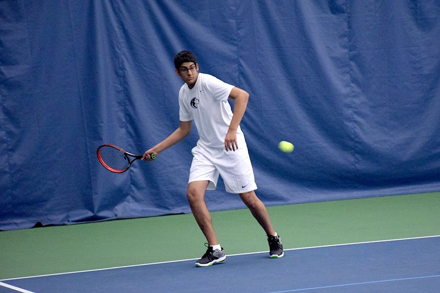 Junior Aqil Lahka tracks down a forehand
