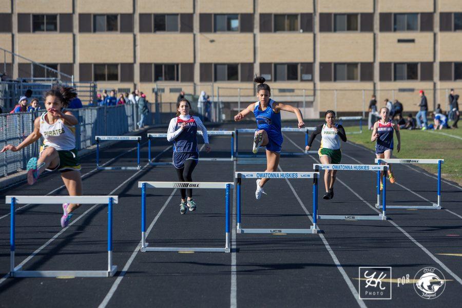 Amelia Vandezande leaps over the hurdle