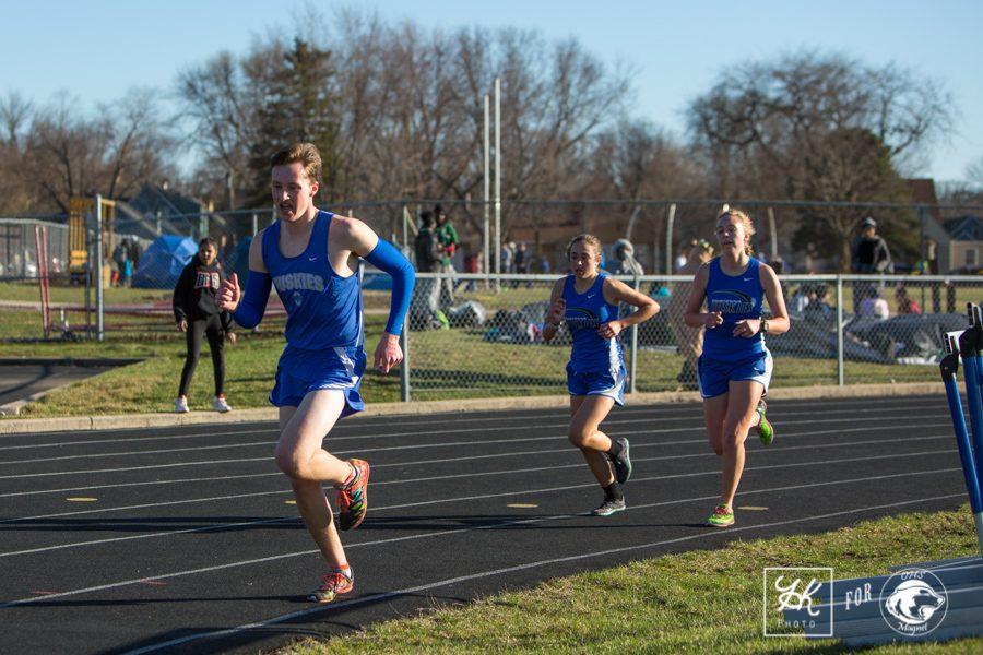 Bryce Knutson, Grace Cocchiarella, and Mariah Dant run around the track