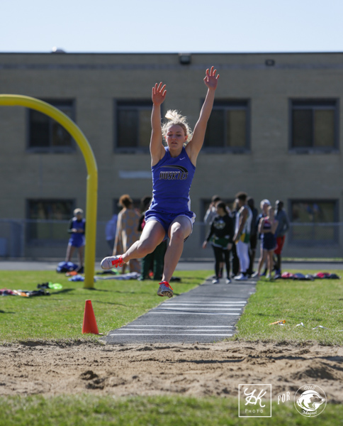 Karissa Gregory jumping into the pit