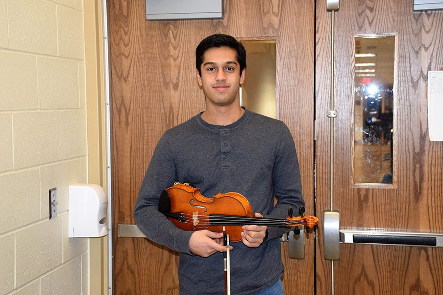 Roshan+Poduval+posing+with+his+violin.
