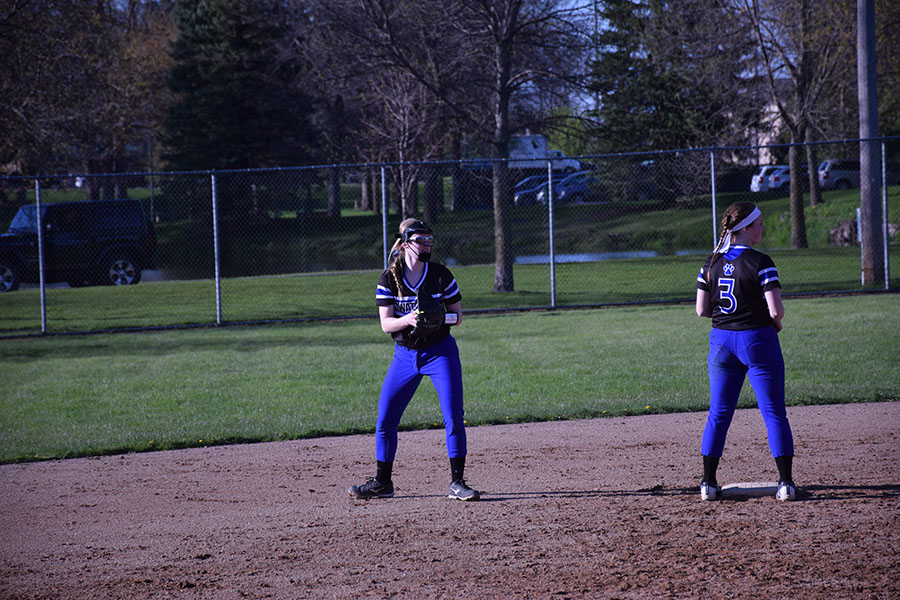 Senior Ellie Rohman looks to find a teammate while Junior Jenna VonRuden stands nearby