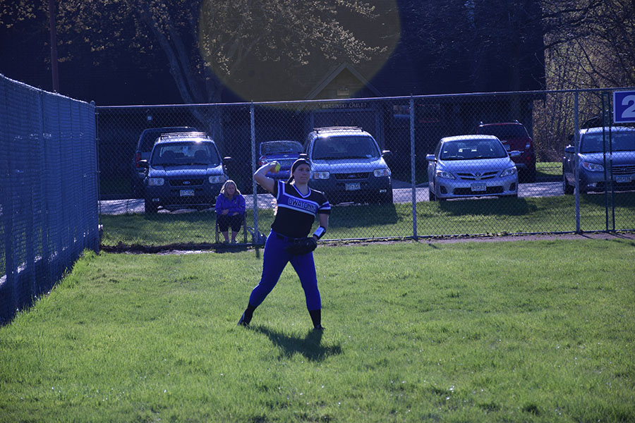 Junior Erin Peterson  throws the softball to a teammate