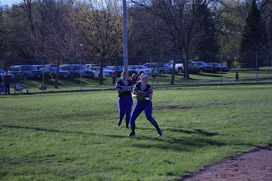 Junior Jenna VonRuden looks to throw the softball as teammate Erin Peterson watches from behind