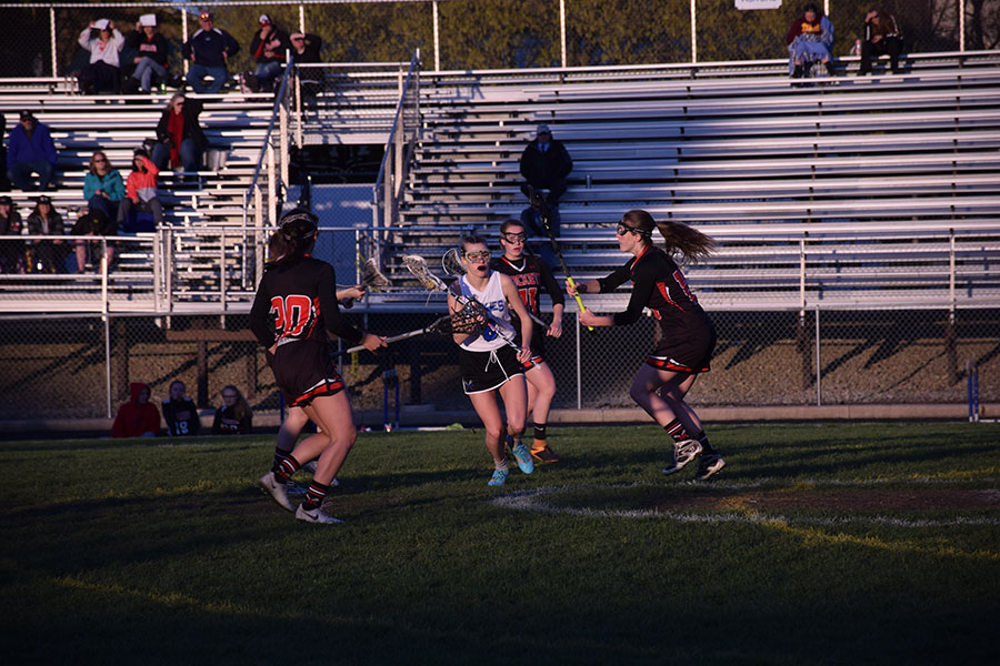 Junior Laura Ebeling runs through four JM defenders as she looks to shoot