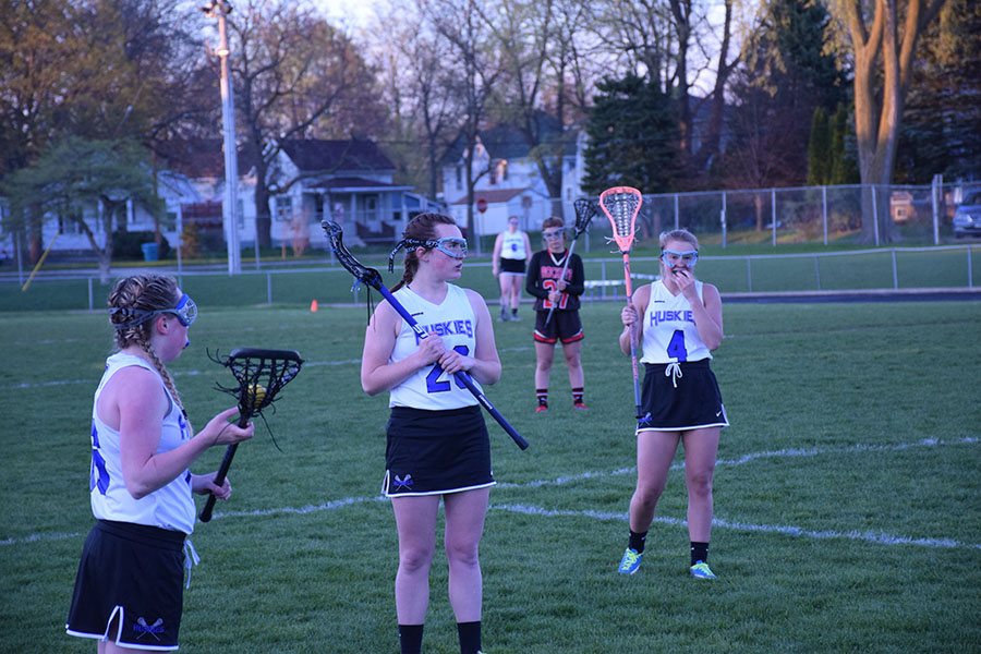 Senior Amy Oldenburg, Junior Kenna West, and Sophomore Taylor Woltman look for the signal from the referee to play on