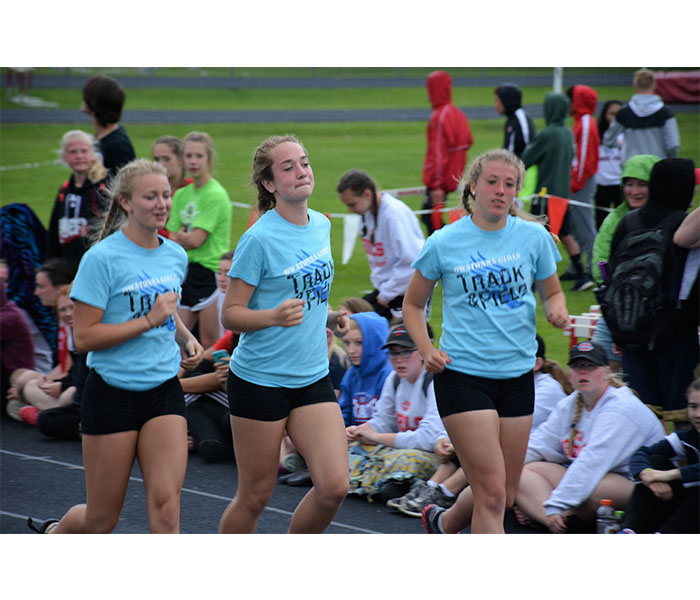 Senior Karissa Gregory and Juniors Syd Schultz and Margo Achterkirch Jogging at the big nine meet.