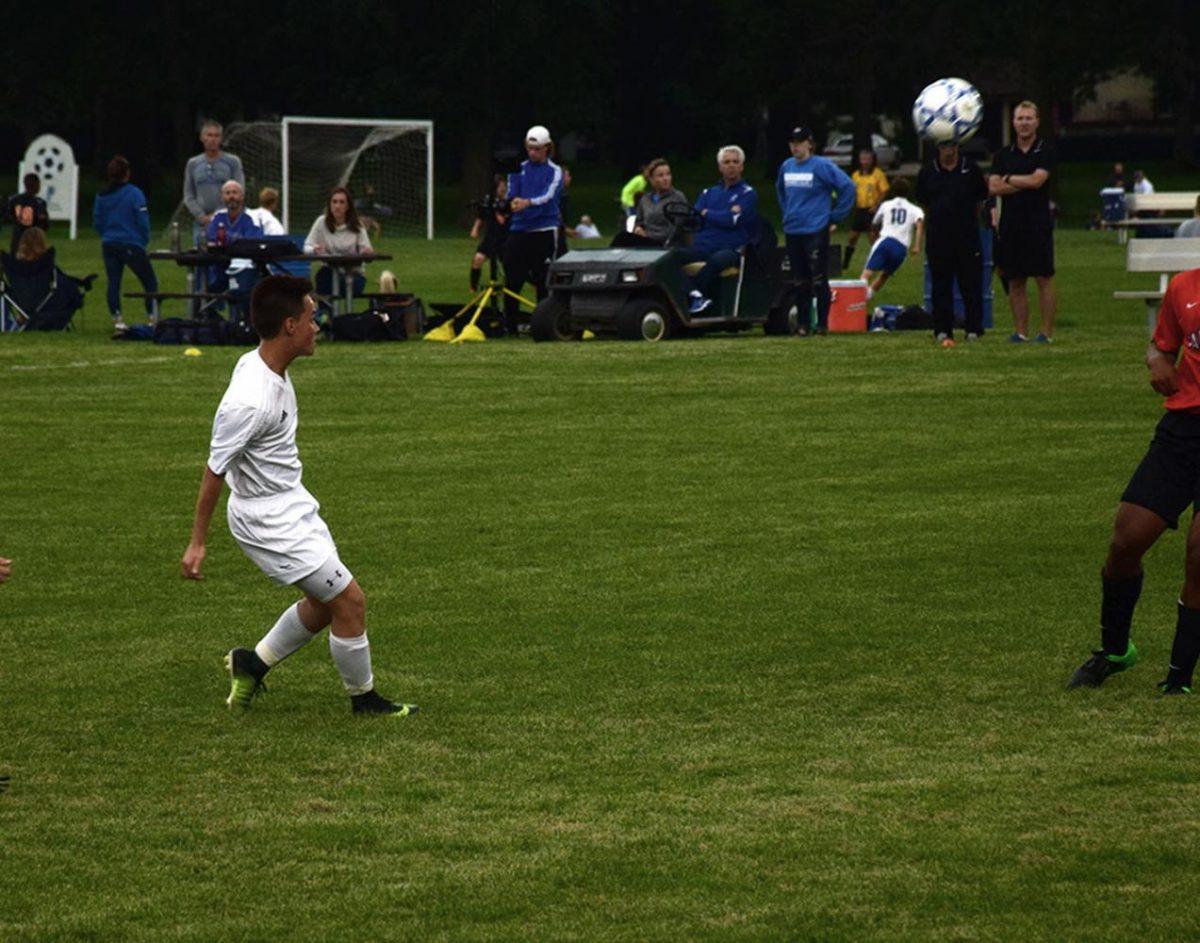 Senior Seth Bungum kicks the ball