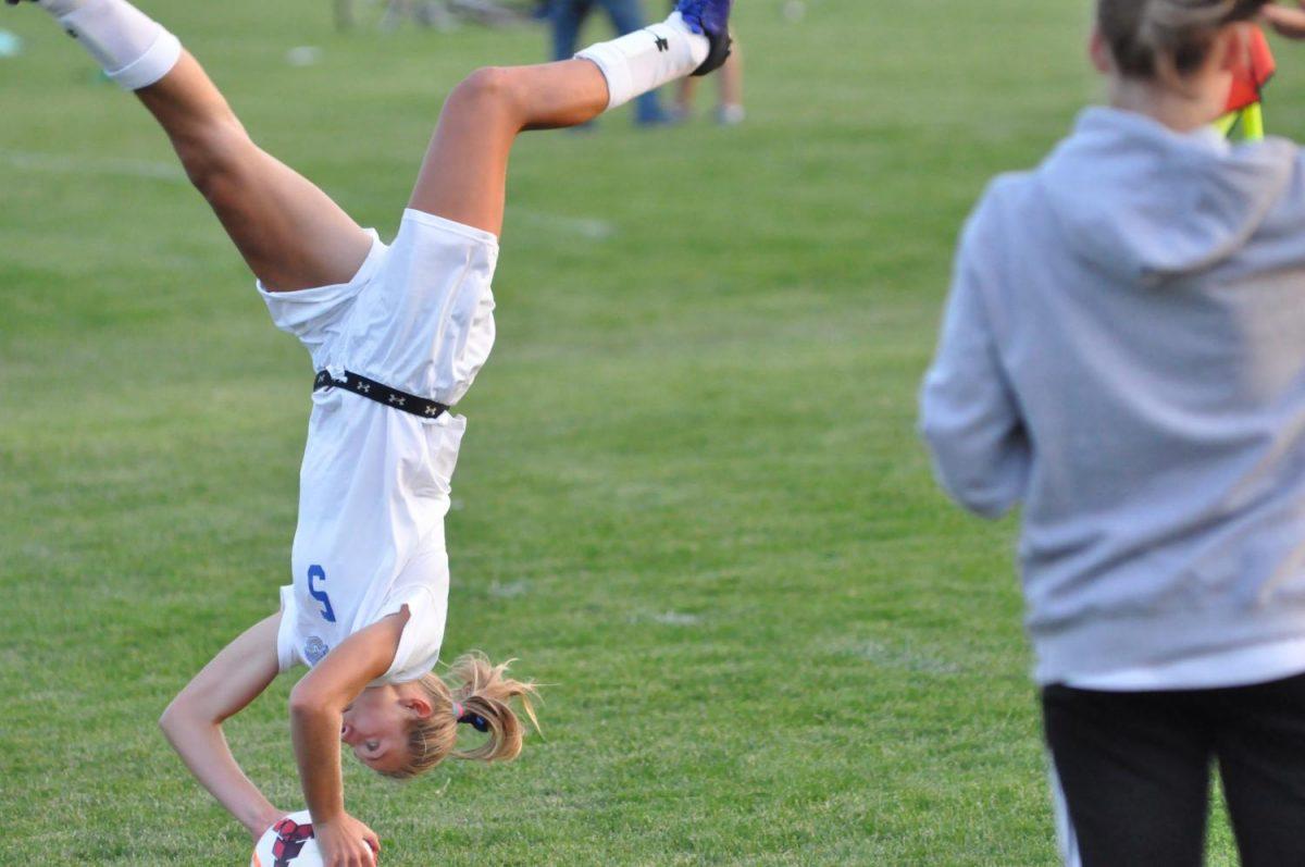 Junior Sydney Kretlow performs a flip throw