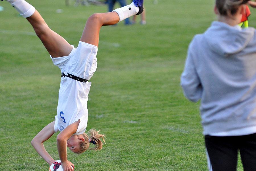 Junior Sydney Kretlow doing flip throw into game