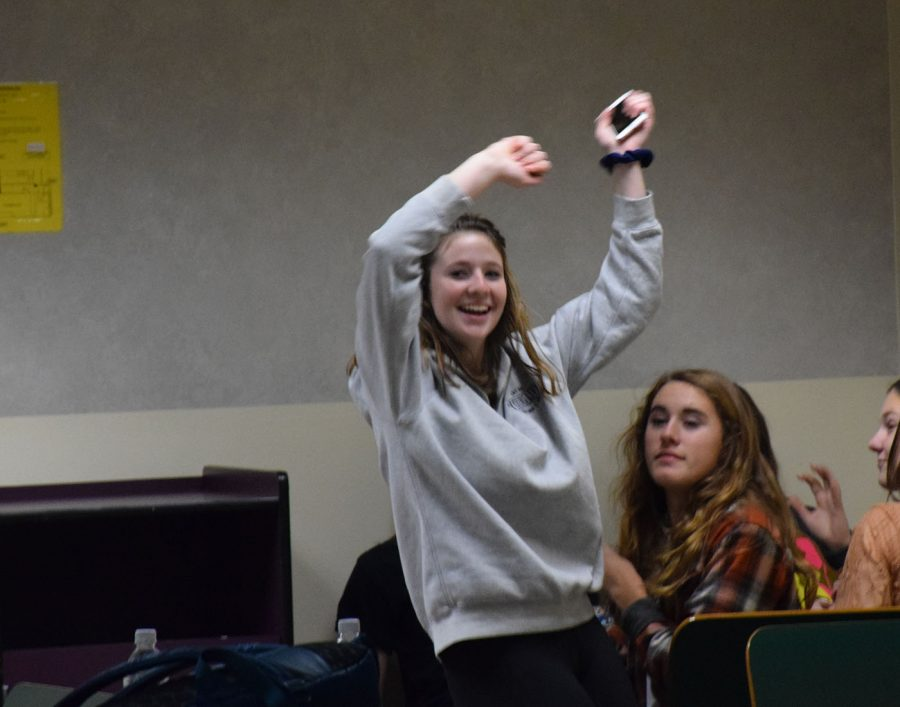 Carly Christenson (sophomore) dancing to the beat of the cash drive.