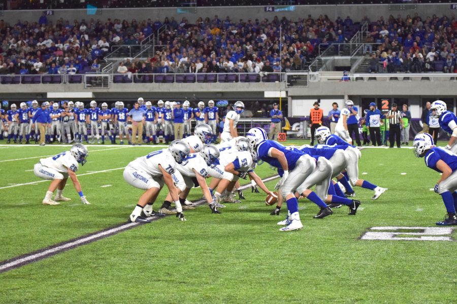 Owatonna offense lining up before a gain in yardage