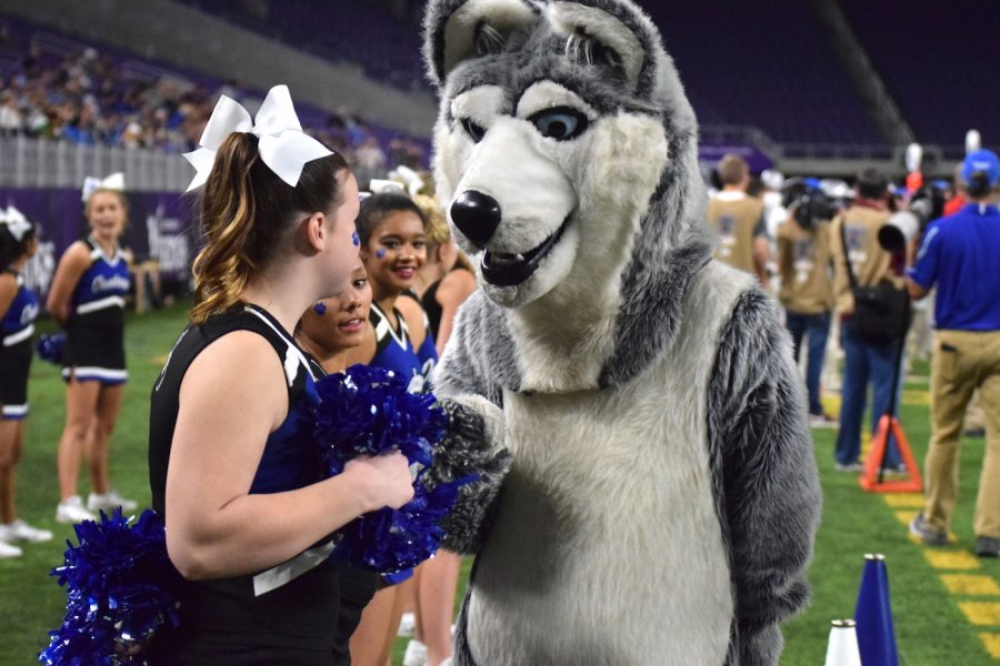Fist bump for the cheerleaders supporting the Huskies