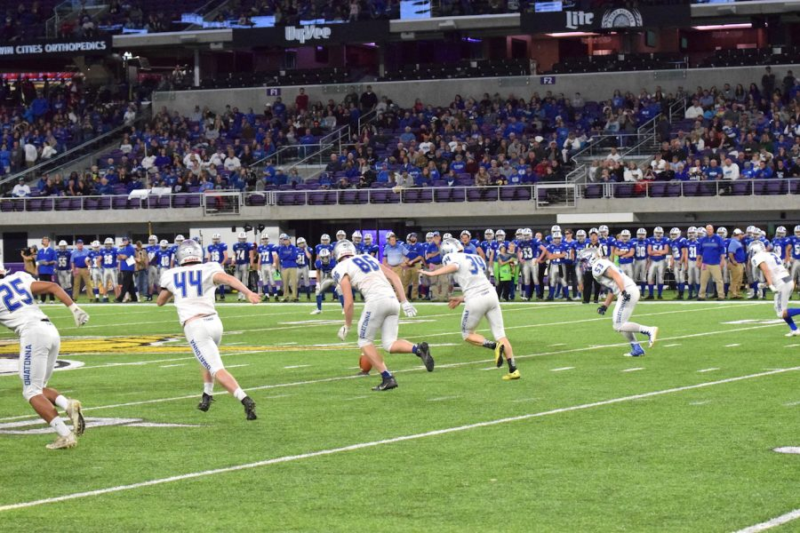 Senior Josh Nelson boots it down field for the kickoff