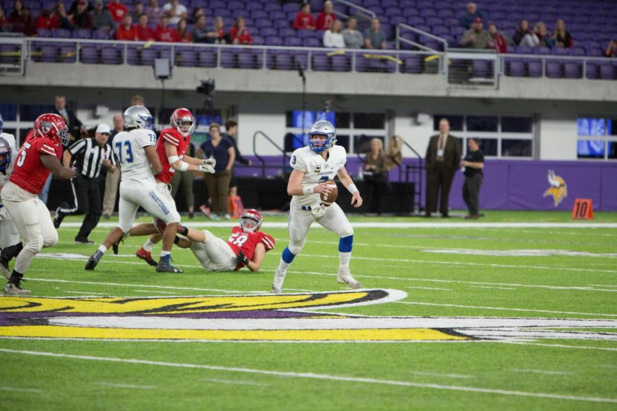 Quarterback Abe Havelka rolls out of the pocket for a pass