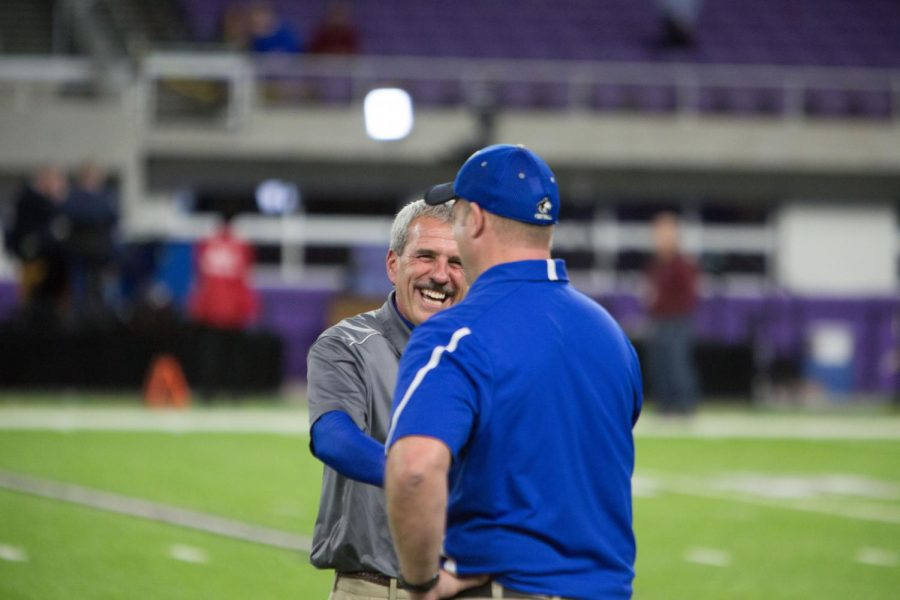 Coach Jeff Williams shakes hands with Coach Marc Achterkirch