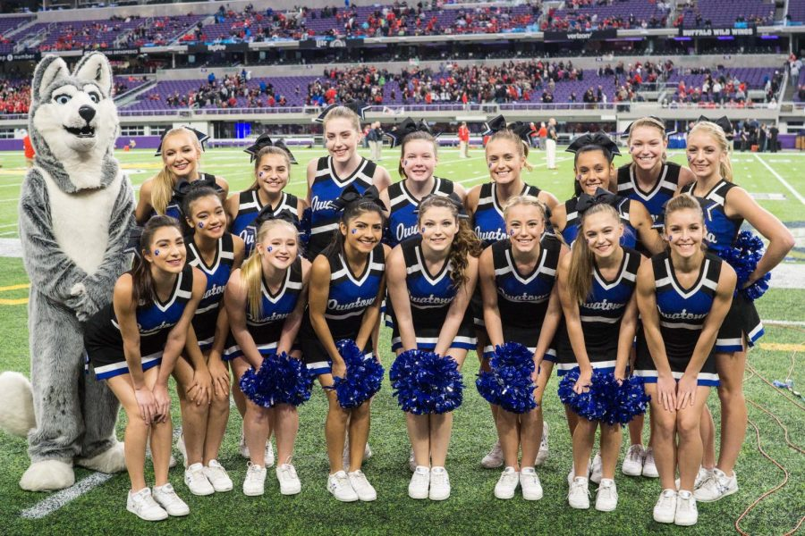 Cheerleaders pose for a photo