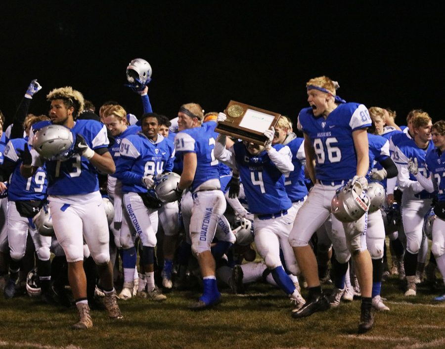 The team celebrates after winning the Section 5A final
