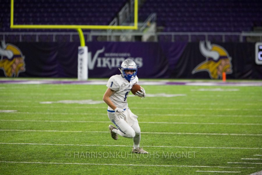 Noah Budach runs down the field