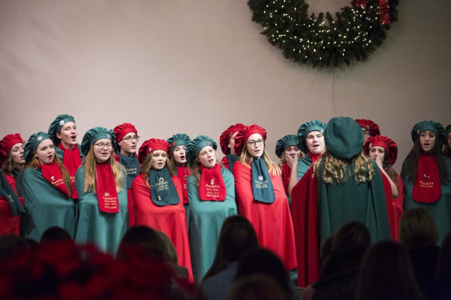 OHS Carolers performing around Owatonna