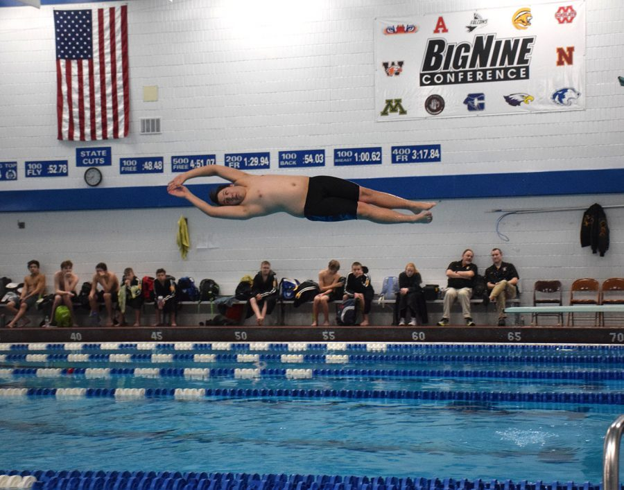 Sophomore Will Ruch preforms a dive