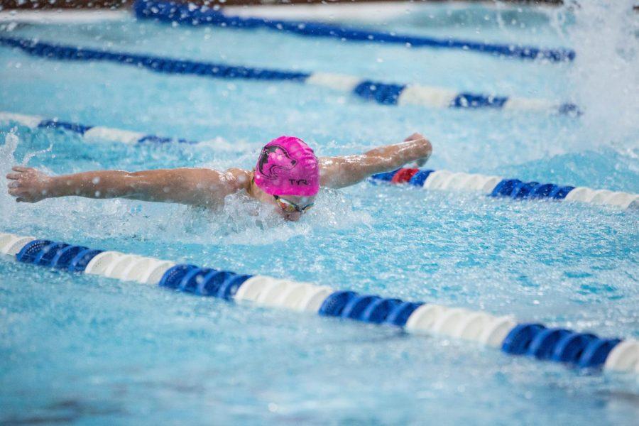 Freshman Fletcher Schultz swim the fly