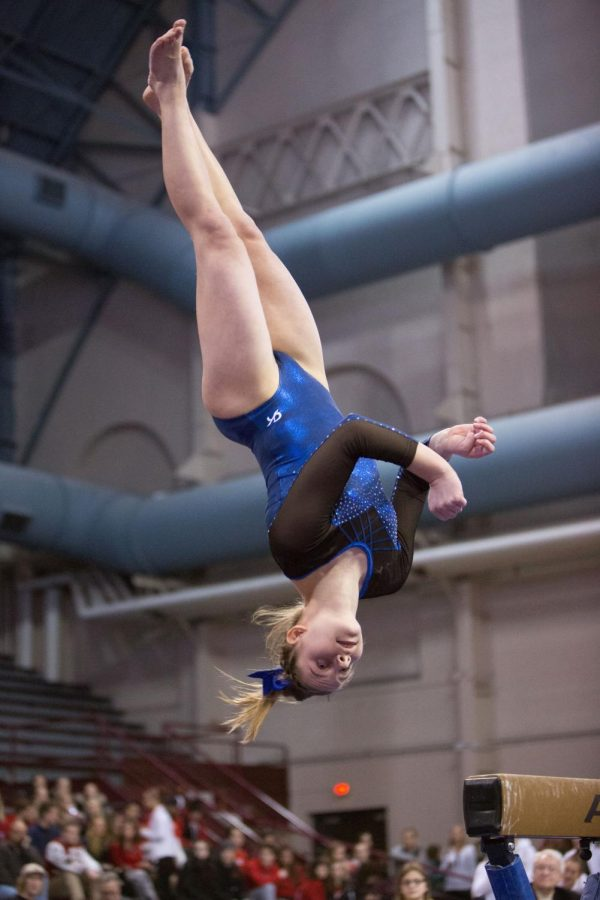 Lucy Matius dismounts from the beam after her routine