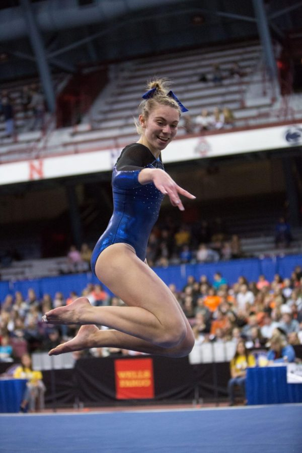 Junior Sydney Kretlow leaps during her floor routine