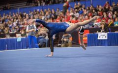 As a freshman Lindsay Bangs performs floor routine at State.  Next year Bangs will go to Gustavus.