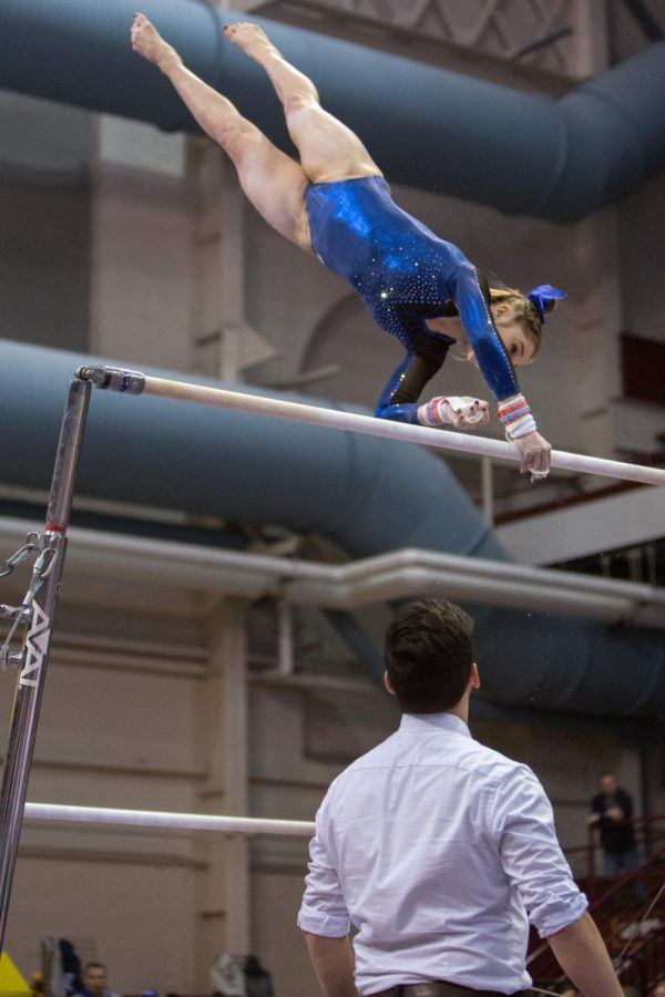 Becca Olson Switches hands during her bars routine