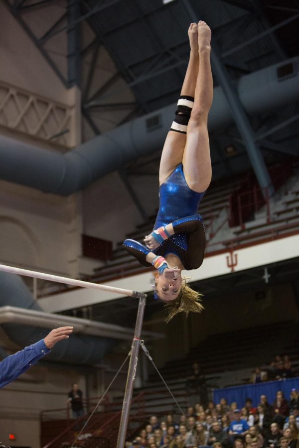 Lucy Matius flies through the air while dismounting from the uneven bars