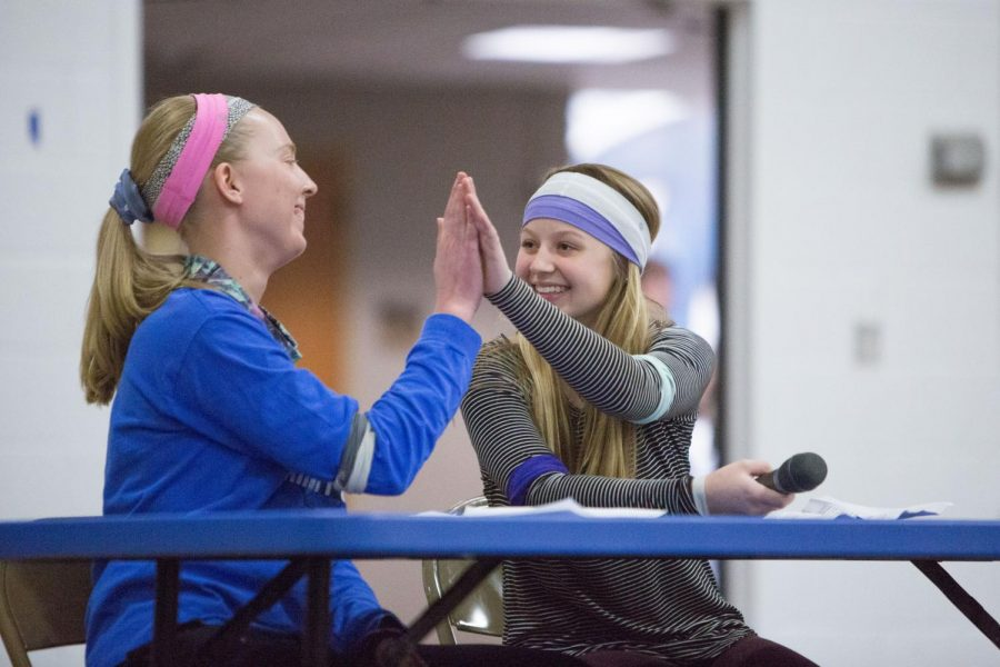 Hanna Gebur and Kenna West hi-five during their fashion show