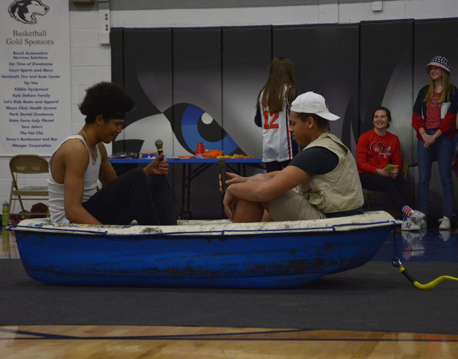 Andrew Jackson (Left) and Kenny Johnson (Right) sit in a boat during the skit