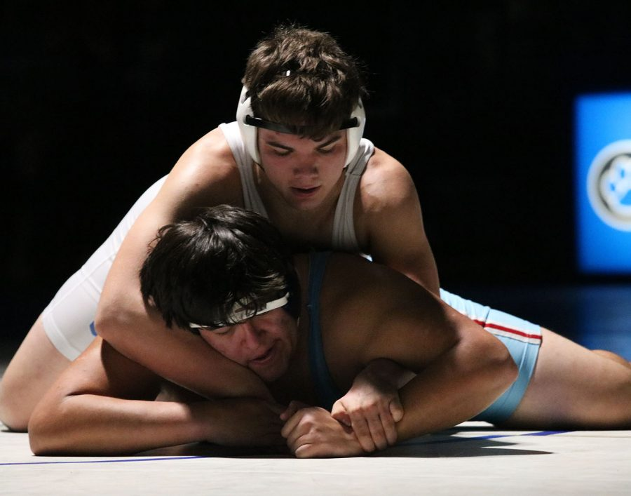 Isaiah  Noeldner working to turn his opponent