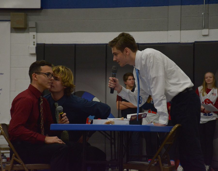 Seniors Will Titchenal and Braeden Meier stare down Brandon Guenther in their snow week skit