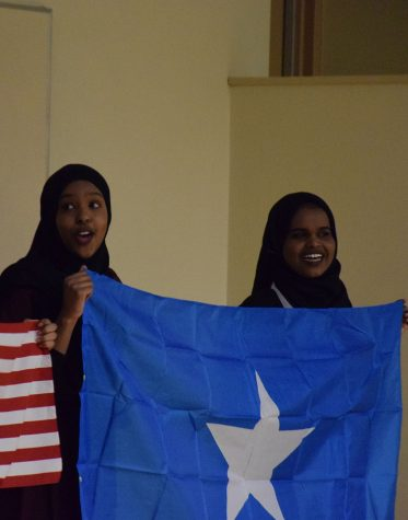 Presenters holding up Somali Flag.