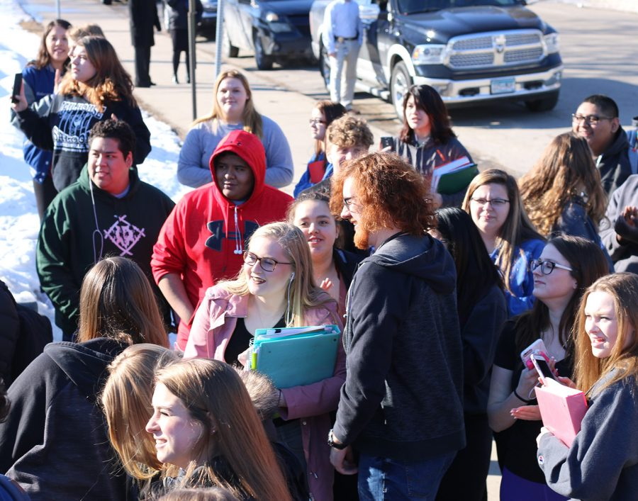 Students smile as they watch more and more students pour out of the doors of the OHS