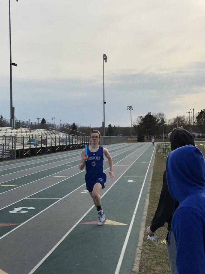 Junior Zach Barret running 4x4