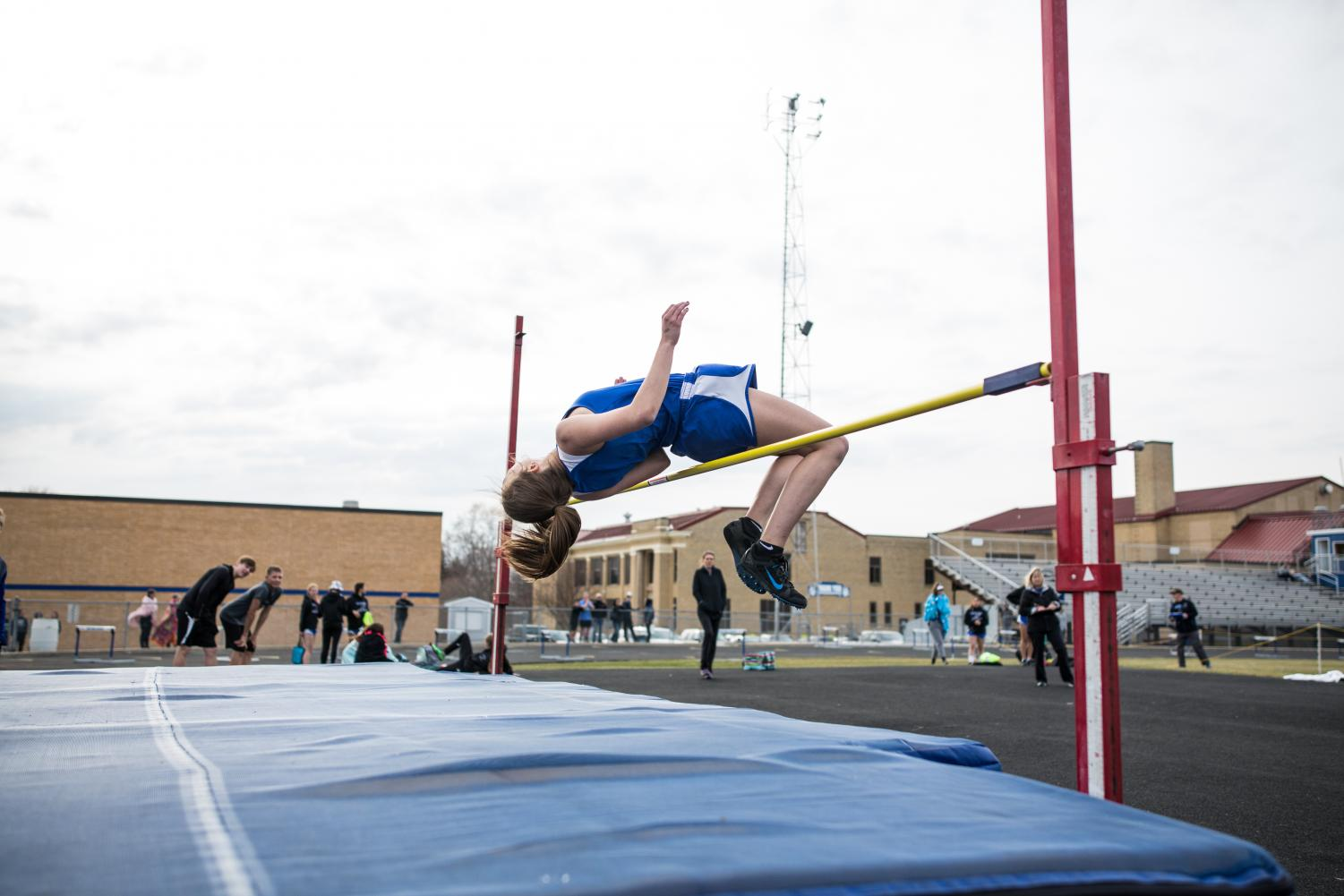 Maggie Newhouse jumping over the high jump bar!