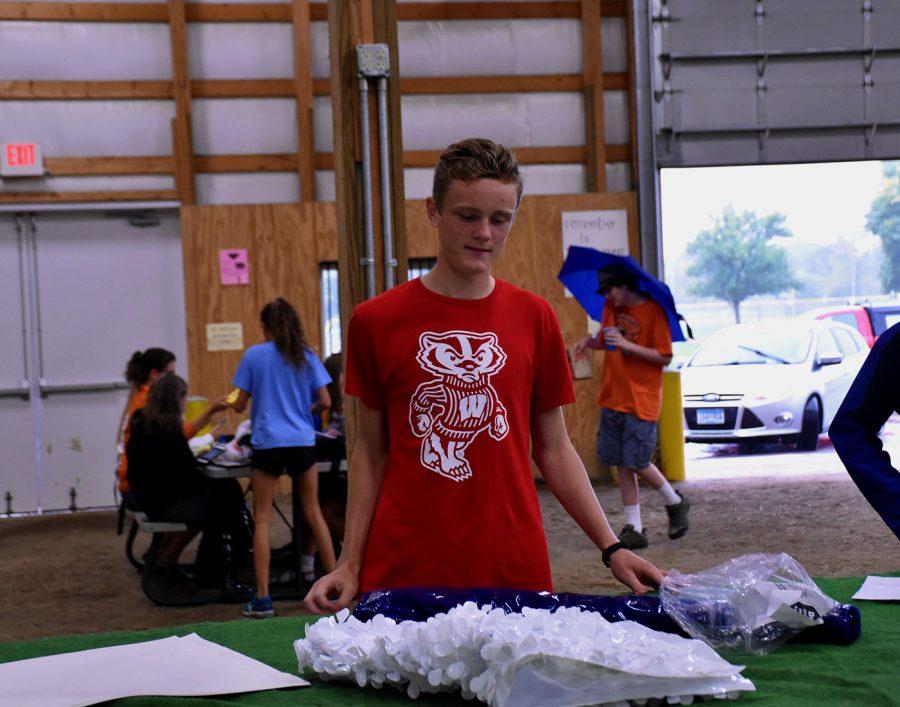 Zach Barrett working on the Boys Soccer float
