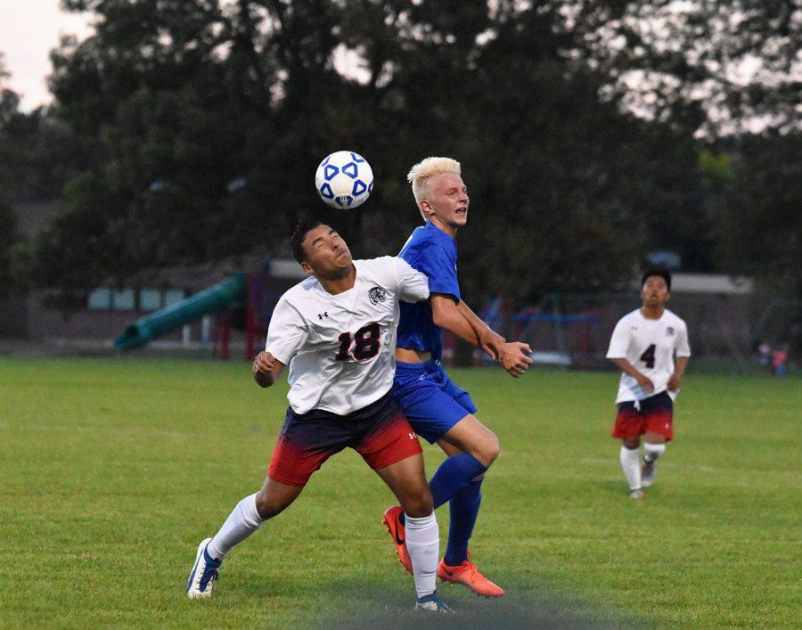 Sophomore Lane Versteeg battles for a ball against Albert Lea