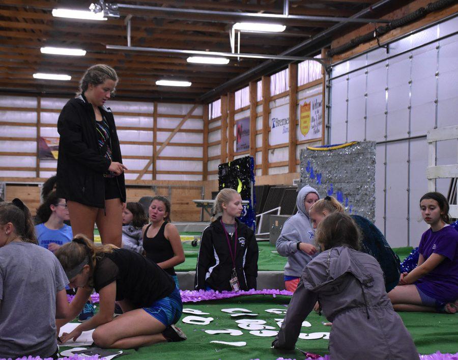 Girls CC float working hard